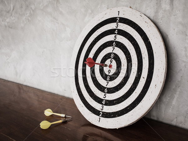 Success concept, darts hit target on dartboard Stock photo © FrameAngel