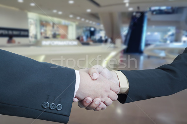 Business handshake with blur background of shopping mall market Stock photo © FrameAngel