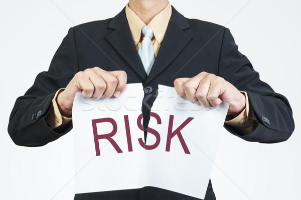 Businessman tearing sheet paper, risk management concept Stock photo © FrameAngel