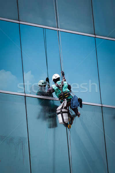 worker cleaning windows service on high rise building Stock photo © FrameAngel