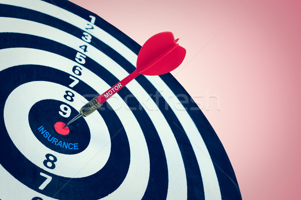 Business motor insurance concept and darts board Stock photo © FrameAngel