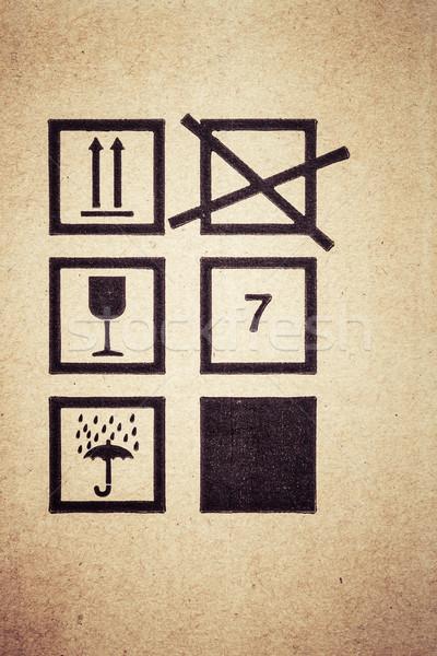 symbol fragile icon background on cardboard box Stock photo © FrameAngel