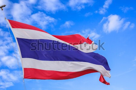 defective waving flag of Thailand and blue sky background Stock photo © FrameAngel
