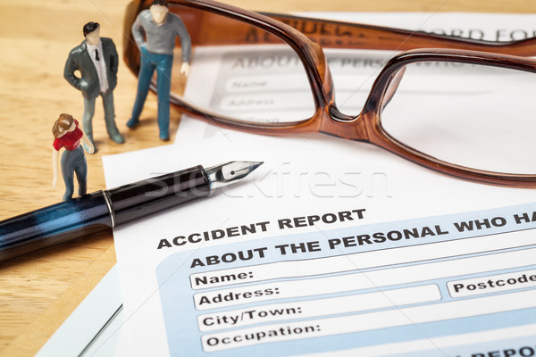 Accident report application form and pen on brown envelope and e Stock photo © FrameAngel
