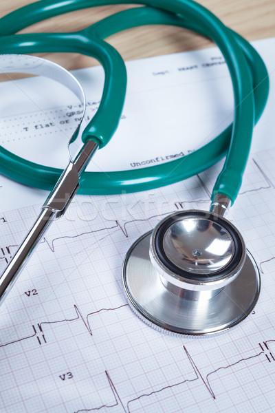 Stethoscope on an electrocardiogram (ECG) chart background Stock photo © FrameAngel