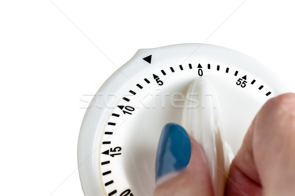 Hand tuning white button, button switch time scale on white back Stock photo © FrameAngel