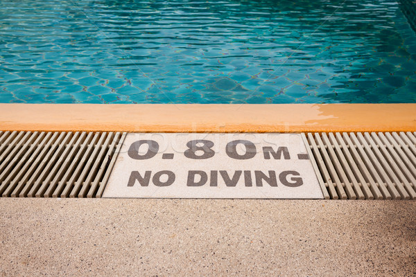 warning sign '0.80m No Diving' at Swimming pool of luxury hotel Stock photo © FrameAngel