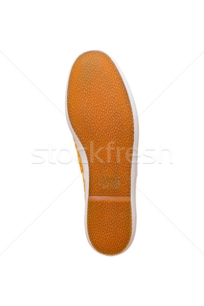 Rubber sole of a men's sneaker on white background Stock photo © FrameAngel
