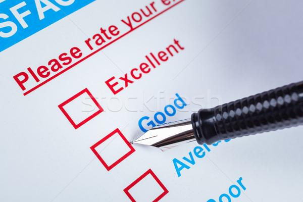 Satisfacción del cliente estudio caja pluma senalando buena Foto stock © FrameAngel