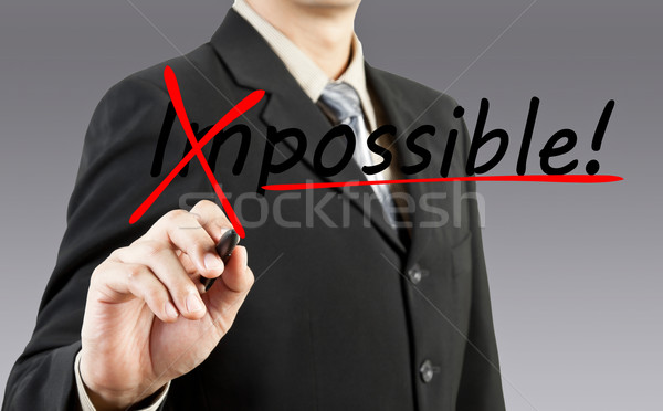 Motivation affaires mot impossible verre aider Photo stock © FrameAngel