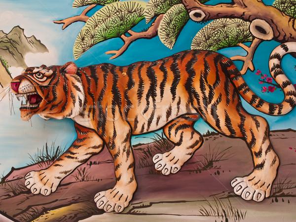 Tiger sculpture on wall  Stock photo © FrameAngel