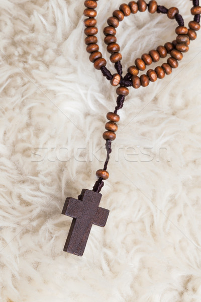 Christian cross necklace on sheep wool, Jesus religion concept a Stock photo © FrameAngel