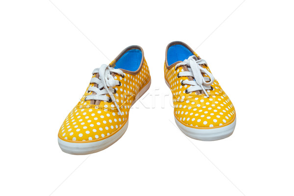 Pair sneakers, vintage dot yellow color  isolated on white backg Stock photo © FrameAngel