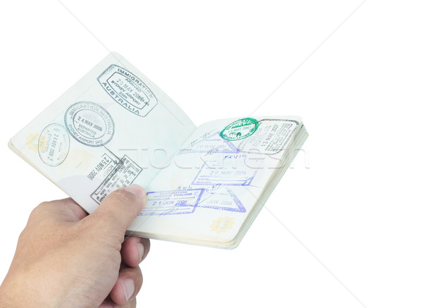Passport stamp and hand on white background Stock photo © FrameAngel