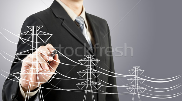 business man drawing electric pylon and wire Stock photo © FrameAngel