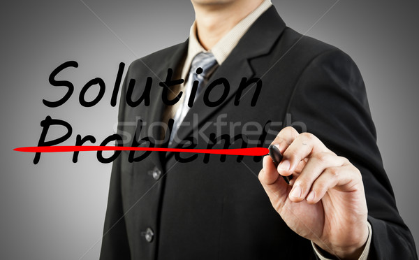 Motivation concept. Businessman write the word problem and solut Stock photo © FrameAngel