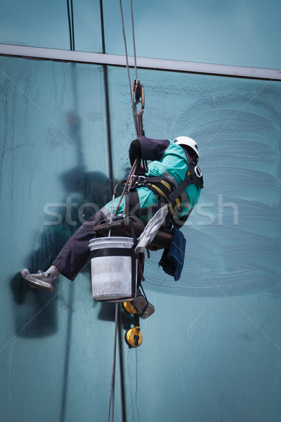 Stock photo: group of workers cleaning windows service on high rise building