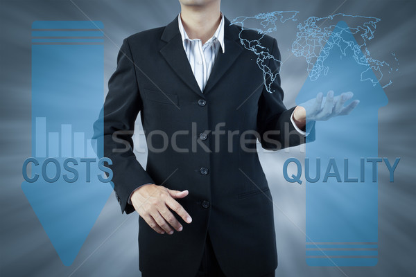 business man standing and presents cost and quality, finance tec Stock photo © FrameAngel