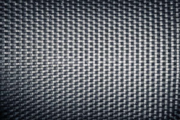 plastic woven wicker pattern, black color background texture Stock photo © FrameAngel