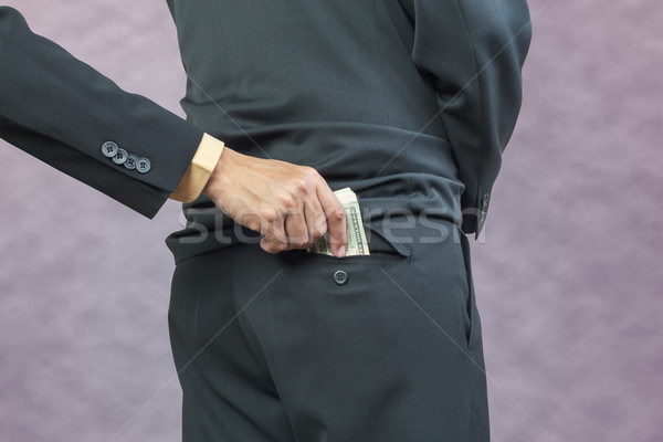 businessman hand put money to back pocket, finance corruption co Stock photo © FrameAngel
