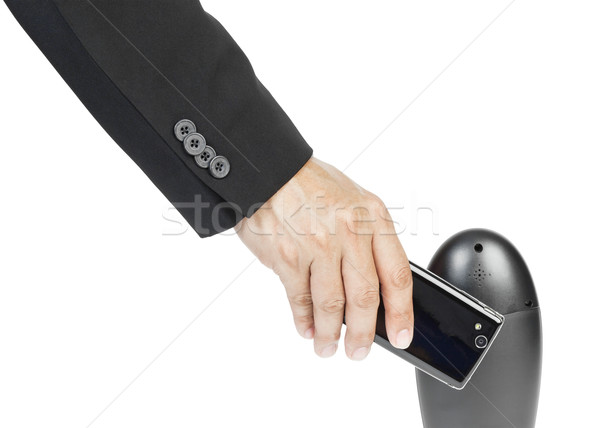 Stock photo: business man holding smartphone as NFC - Near field communicatio