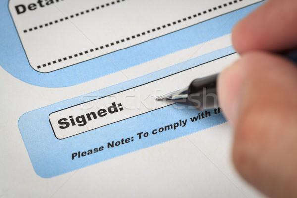 Imza alan belge kalem insan eli burada Stok fotoğraf © FrameAngel