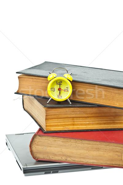 Clock on book as time management concept Stock photo © FrameAngel