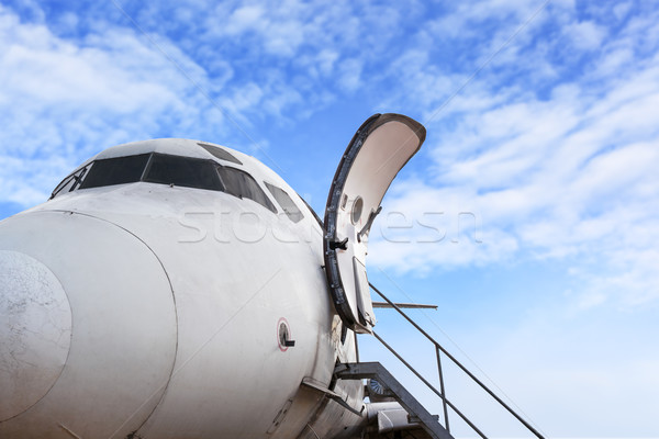 airplane door of private jet and open ladder at the airport on b Stock photo © FrameAngel