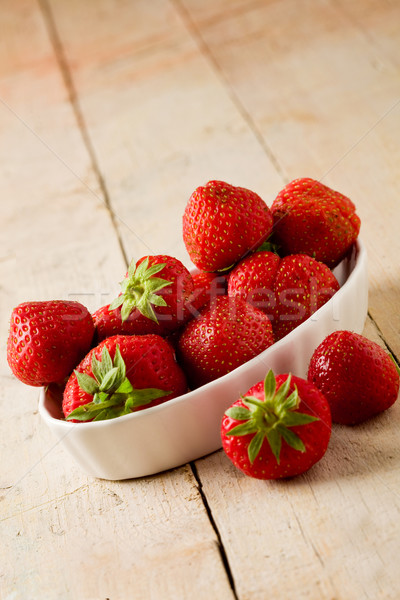 Strawberries on wooden table Stock photo © Francesco83