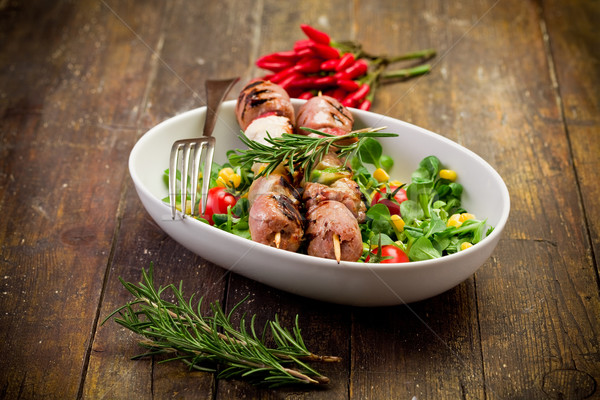 Meat Skewers on wooden table Stock photo © Francesco83