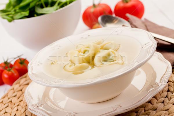 Tortellini húsleves finom tészta zöldségek fehér Stock fotó © Francesco83