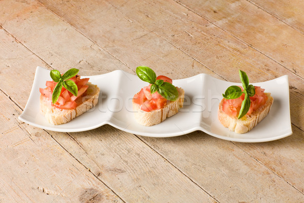 Bruschetta with tomatoes and basil Stock photo © Francesco83