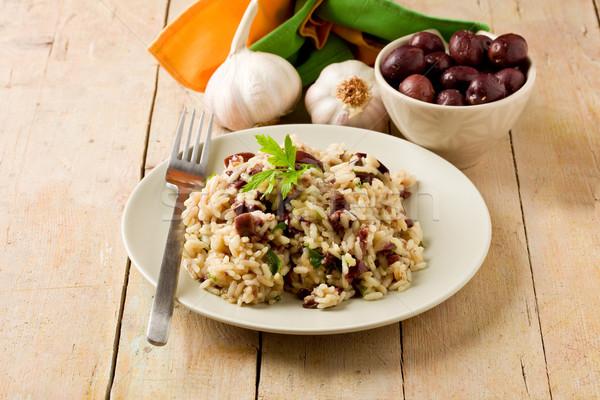 Risotto siyah zeytin ahşap masa lezzetli peçete sarımsak Stok fotoğraf © Francesco83