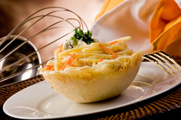 Pasta with Gorgonzola sauce inside parmesan waffle Stock photo © Francesco83