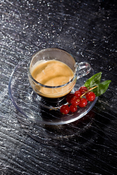 Espresso cofee with currants on black glass table Stock photo © Francesco83
