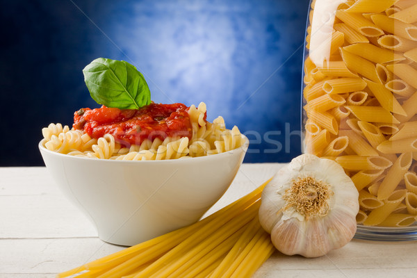 Pasta with tomato sauce on blue background Stock photo © Francesco83