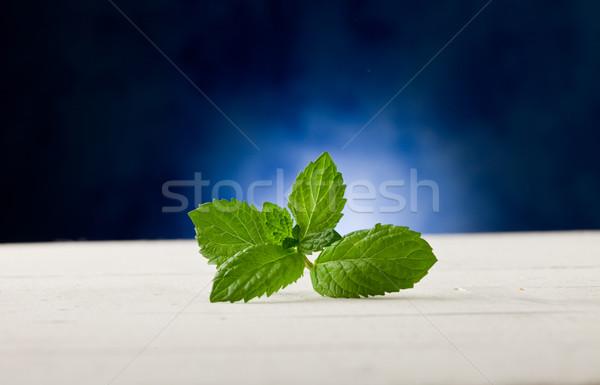 Foto stock: De · folhas · mesa · de · madeira · local · luz · foto