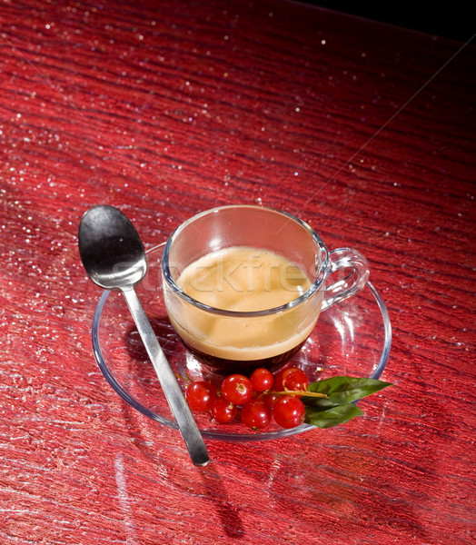 Espresso coffee with currants on red glasstable Stock photo © Francesco83