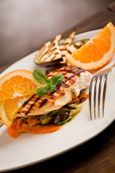 Grilled chicken breast on ratatouille bed Stock photo © Francesco83