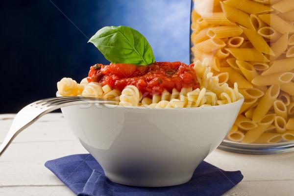 Pasta with tomato sauce on blue background Stock photo © Francesco83