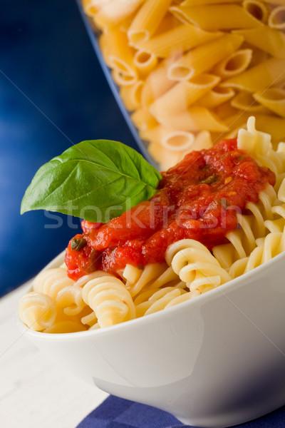 Pasta with tomato sauce and basil on blue background Stock photo © Francesco83