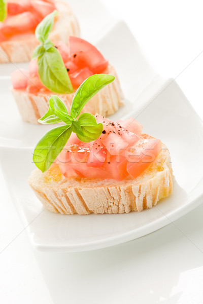 Bruschetta tomates albahaca aislado foto delicioso Foto stock © Francesco83