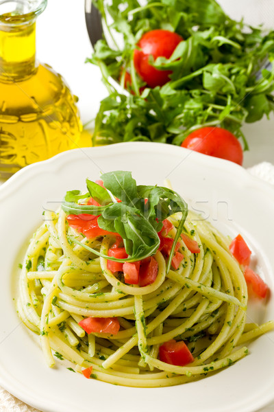 Pasta with arugula pesto and cherry tomatoes Stock photo © Francesco83