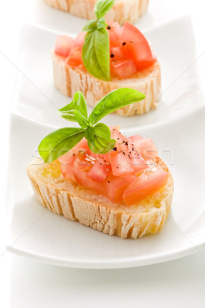 Bruschetta with tomatoes and basil isolated Stock photo © Francesco83