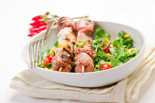 Meat Skewers on white table Stock photo © Francesco83