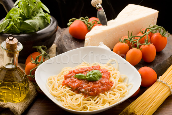 Pasta with tomatoe sauce and ingredients Stock photo © Francesco83