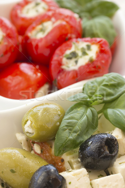 Salad of black, green olives with pieces of cheese. Stock photo © frank11