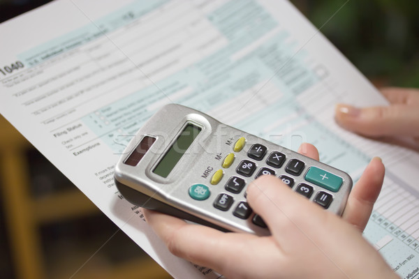 Filling income tax forms with calculator  Stock photo © frank11