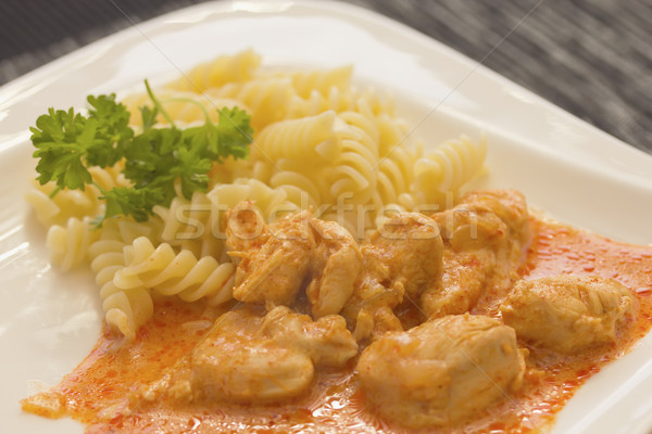 Chicken pieces with Pasta in Paprika Cream Sauce. Horizontally. Stock photo © frank11