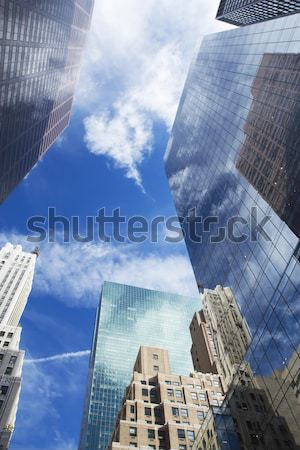 Skyscrapers with clouds reflection  Stock photo © frank11